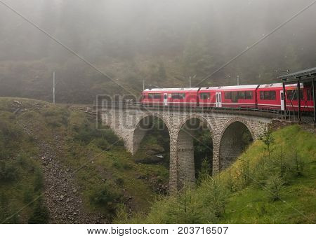 Bernina express train in the Swiss alps lost in the fog