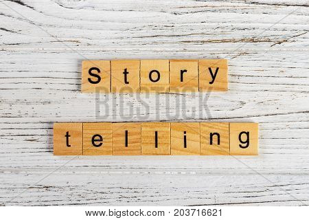 Term Story Telling word made with wooden blocks concept