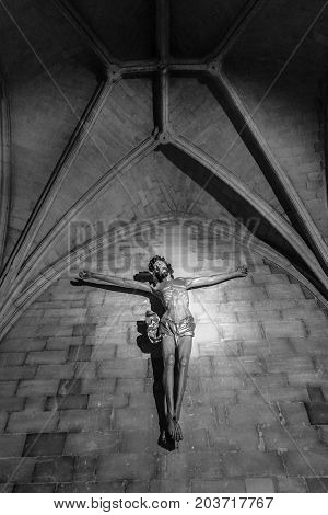 MAASTRICHT NETHERLANDS - JANUARY 09 2015: The Crucifixion. Interior of Basilica of St. Servatius. Black and white. The Basilica of St. Servatius is a oldest Roman catholic church the Netherlands.