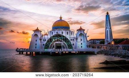 One shot of the iconic Melaka Straits Mosque, in Melaka, Malaysia during sunset with the dramatic sky on that evening.