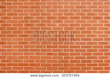 Red brown vintage brick wall with shabby structure. Horizontal wide brickwall background. Grungy red brick blank wall texture. Retro house facade. Abstract panoramic web banner. Stonewall surface
