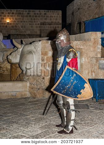Tel Aviv-Yafo Israel September 08 2017: Member of the Knights of Jerusalem club dressed in the traditional armor of a knight posing for photographers at night in the old town of Yafo in Tel Aviv-Yafo Israel