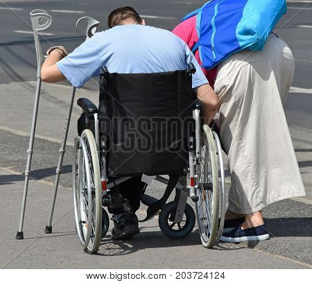 Man in a wheelchair on the street