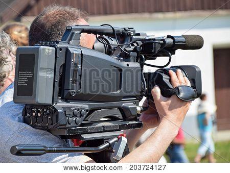 Cameraman at work witha Digital camera outdoor poster