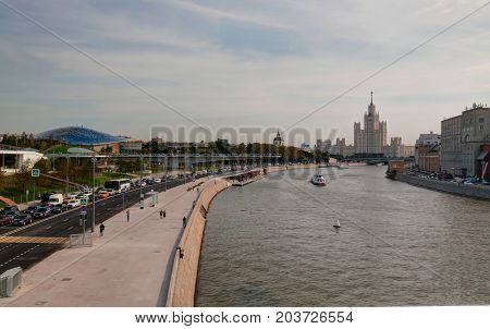 Landscape of modern park Zaryadye and soaring pedestrian bridge and Philharmonic concert hall in Moscow Russia poster