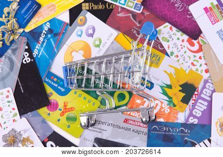 SARANSK, RUSSIA - SEPTEMBER 06, 2017: Shopping cart on various loyalty cards.