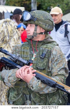 Samara Russia - September 10 2017: Unidentified Russian soldier with sniper rifle in hand at the street during the city festival