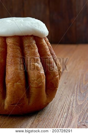 Rum baba on wooden background. cake saturated in hard liquor usually rum and sometimes filled with whipped cream or pastry cream.