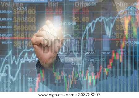 Businessman writing the trading graph of stock market on the virtual screen on photo blurred of cityscape building background Business stock market and trading concept, 3D illustration