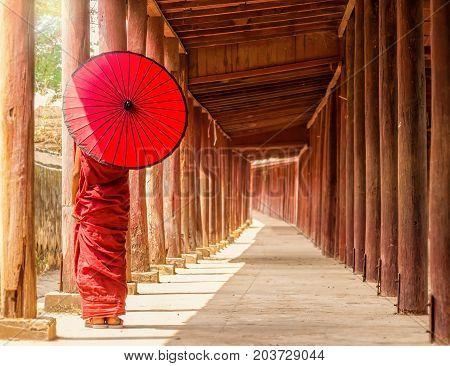 Back side of Buddhist novice standing in pagodamyanmar