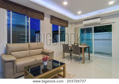 Luxury Interior living room with blue sky at twilight time