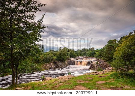 Low Force Waterfall, as the River Tees cascades over the Whin Sill at Low Force, the Pennine Way follows the southern riverbank