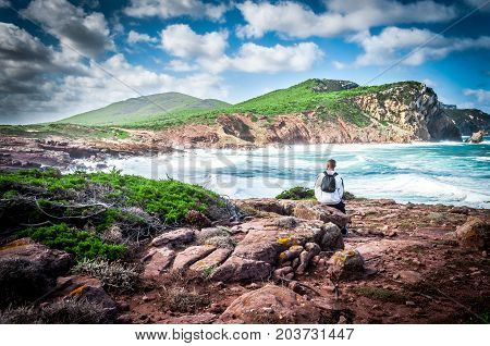 Man With Backpack Staring At The Coast
