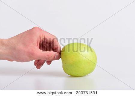 Male Hand Holds Green Apple. Apple In Fresh Juicy Color