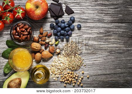 Selection of healthy food on wooden background. Healthy diet foods for heart cholesterol and diabetes