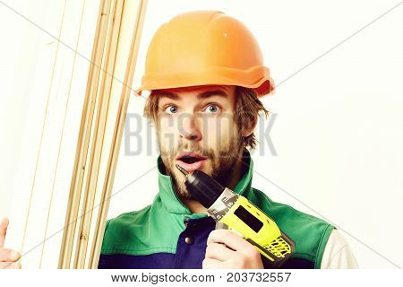 Man With Surprised Face Expression. Builder In Orange Helmet