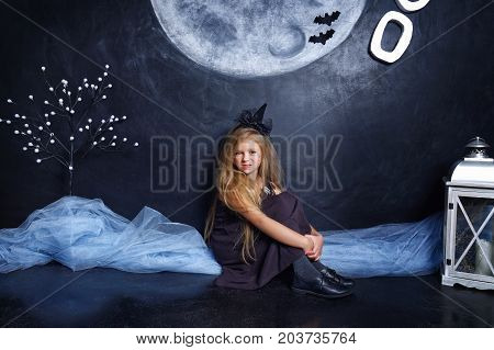 Small Evil Witch Sitting In The Studio