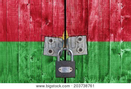 Burkina Faso flag on door with padlock