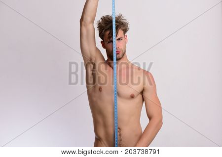 Man Holds Long Blue Measuring Tape Vertically