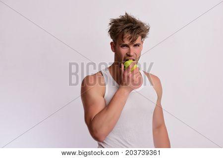 Athlete With Messy Hair Bites Fresh Fruit