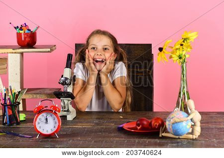 Girl With Cheerful Face Sits At Desk. Laboratory And Beauty