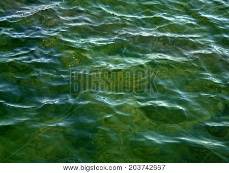 Beautiful calm Emerald Green waters with soft ripples on surface