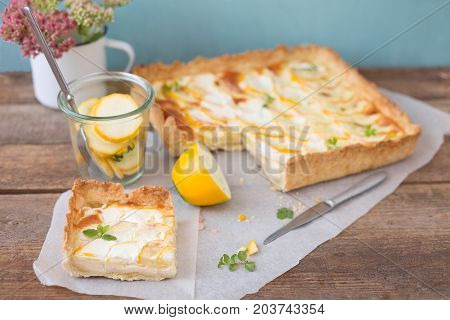 Zucchini tart with thin slices of yellow zucchini beautifully layered on top.