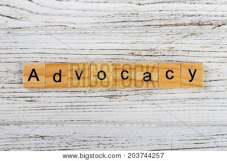ADVOCACY word made with wooden blocks concept