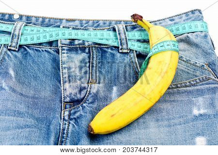 Health And Male Sexuality Concept: Kinky Fruit On Denim Trousers