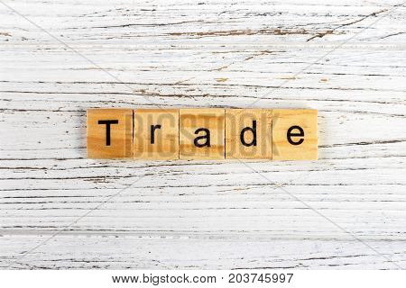 TRADE word made with wooden blocks concept