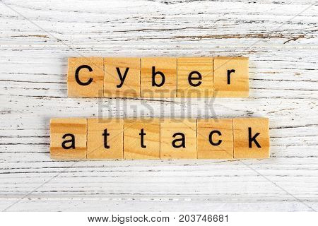cyber attack word made with wooden blocks concept