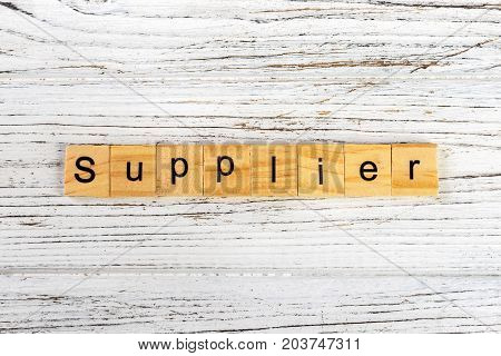 SUPPLIER word made with wooden blocks concept
