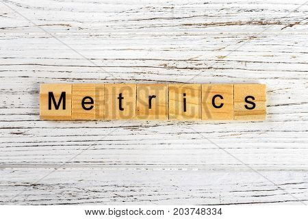 METRICS word made with wooden blocks concept