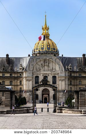 Paris France - July 08 2017: Les Invalides (The National Residence of the Invalids) is a complex of museums and monuments relating to military history of France. The northern portal of the complex with Louis XIV with horse on the pediment.