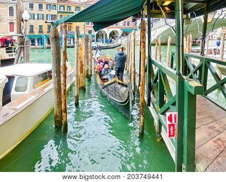 Venice, Italy - May 04, 2017: gondola sails down the channel in Venice, Italy on May 04, 2017. Gondola is a traditional transport in Venice, Italy