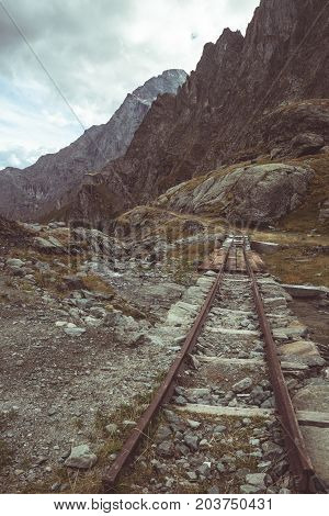 Old And Damaged Railroad Track Used In The Italian Alps For High Altitude Dam Construction, Material