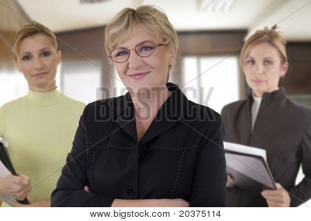 business team of three senior businesswomen at the office