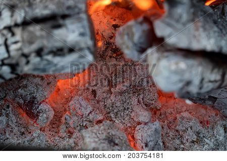 Burnig charcoals and remaining ashes with ember
