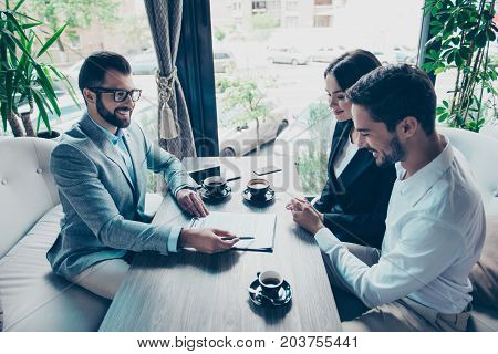 Business Meeting At The Restaurant. Happy Couple Is Buying New House, Young Bearded Attractive Brune