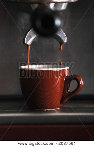Espresso Dripping From Commercial Coffee Machine