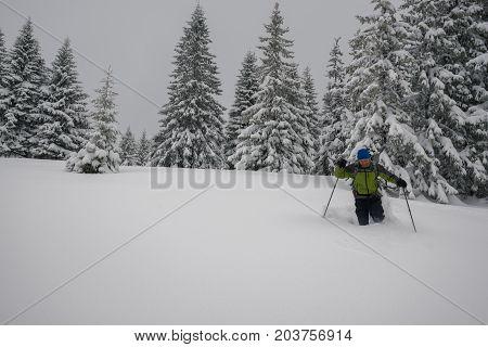 Traveler Man Is Walking In Deep Snow