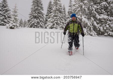 Adventurer Man Goes Snowshoeing On Deep Snow