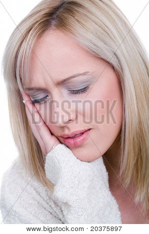 young woman is having strong headache or toothache