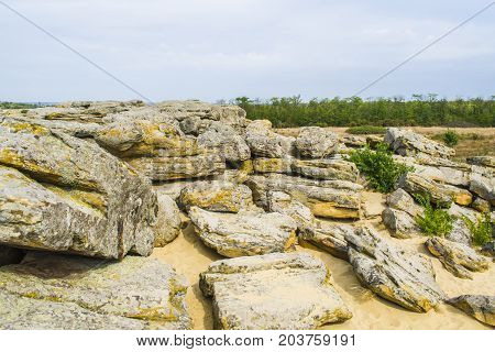 Rocky Terrain In Abandoned Places. Blue Clouds.