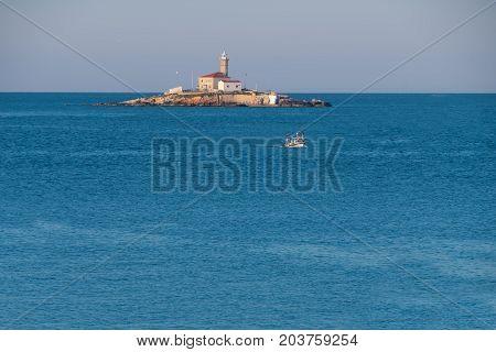 Lighthouse on a small island Sveti Ivan near Rovinj, Croatia
