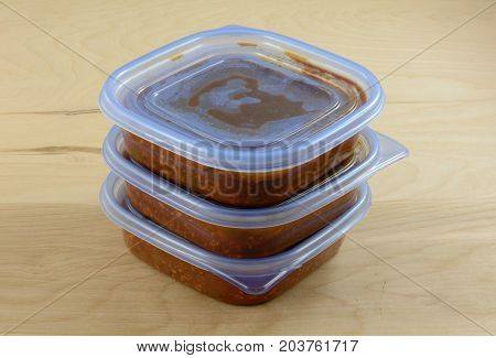 Batch of cooked turkey spaghetti sauce pit in storage containers for freezing for quick future meals