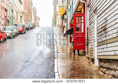 Quebec City, Canada - May 31, 2017: Old Town Steep Street During Heavy Rain With Drops And Wet Road