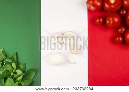 Italian food ingredients are on Italian flag.