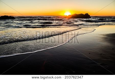 Sun Setting Behind a Seastack in Lincoln City on the Oregon Coast