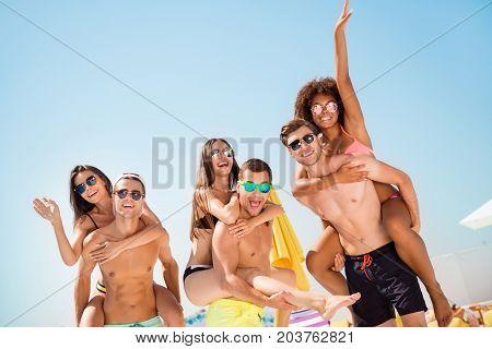 Freedom, Funky, Sunny, Romance, Carefree, Chilling Mood. Three Happy Boyfriends Piggybacking Their G